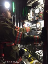"Foreman Adam Bartley operating the E-141 pump panel during the ""Hydrant Service"" drill"