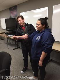 EMT Michael Miller practicing how to splint on Probationary EMT Candidate Andreya Pastrana