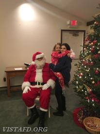 Santa with Probationary EMT Candidate Jasmine Lilly and Junior Firefighter Ava Baiocco