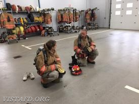 "Lt. Phil Katz going over a ""2-minute drill"" with Probationary FF Olivia Buzzeo"