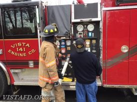 Foreman Adam Bartley and Mutual Responder Dave Jacobsen operating the E-141 pump panel