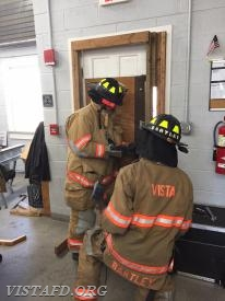 "FF Mark Albert & Foreman Adam Bartley practicing ""Forcible Entry"""