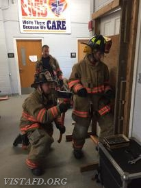 "Capt. Mike Peck & Probationary FF/EMT Candidate Olivia Buzzeo practicing ""Forcible Entry"""
