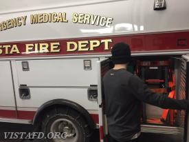 "FF Ryan Ruggiero looking for where the stair chair is located during the ""EMT Fundamentals Class"""
