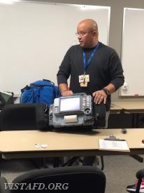 Westchester EMS Paramedic Hamlet Cuello going over how to assist paramedics on an EMS scene