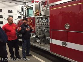 "Foreman Castelhano & Lt. Katz going over Engine 142 during the ""Apparatus Review"" drill"