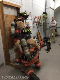 Firefighter Patrick Healy & Firefighter J.T. Bowensmith conducting forcible entry procedures