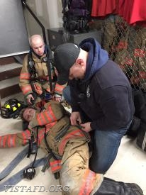 Lead Foreman Marc Baiocco showing how to package a downed Firefighter