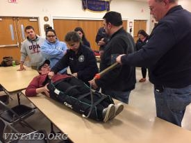 EMT Greg Pastrana reviewing how to use the vacuum splint