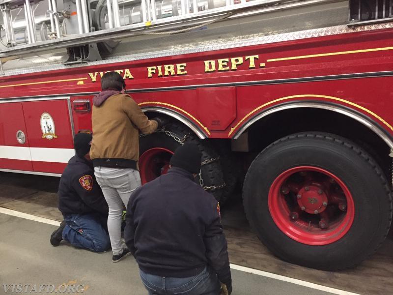 Lt. Phil Katz, Foreman Karen Lilly and Firefighter Martin Rojas putting chains on Tanker 4