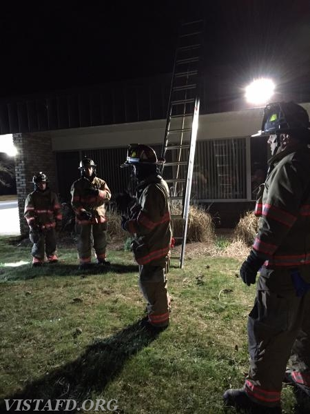 Lt. Phil Katz reviewing how to properly operate a ladder