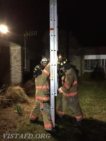 Vista Firefighters practice raising a ladder