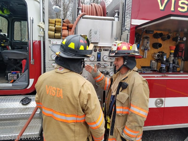 """Lt. Phil Katz going over the Engine 142 pump panel with Foreman Dan Castelhano during """"MPO Class"""""""