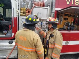 "Lt. Phil Katz going over the Engine 142 pump panel with Foreman Dan Castelhano during ""MPO Class"""