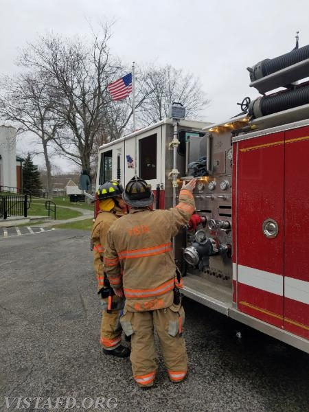 """Capt. Mike Peck going over the Engine 143 pump panel with FF Martin Rojas during """"MPO Class"""""""