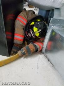FF Dom Mangone going through an SCBA mask confidence course