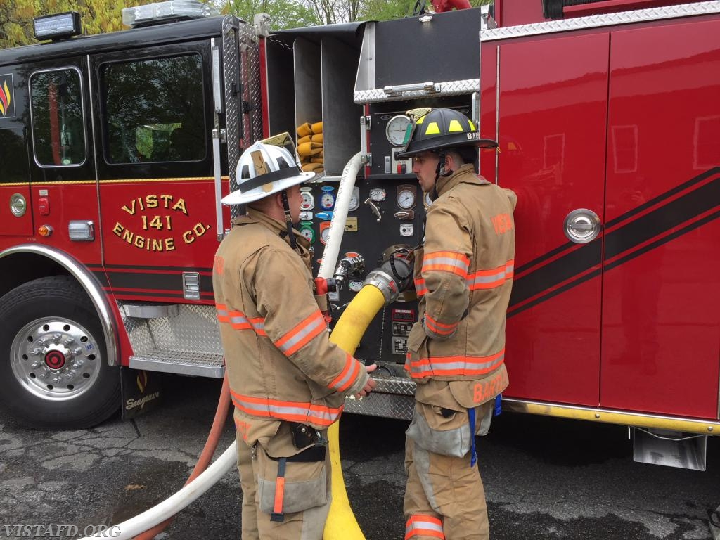 Asst. Chief Mike Peck going over the E-141 pump panel with Foreman Adam Bartley