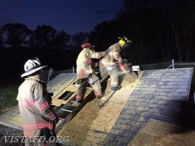 Vista Firefighters practicing how to ventilate a roof