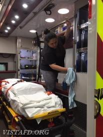 Probationary EMT Candidate Andreya Pastrana cleaning Ambulance 84B1