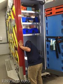 Probationary EMT Candidate Nicholas Kaplan cleaning Ambulance 84B1