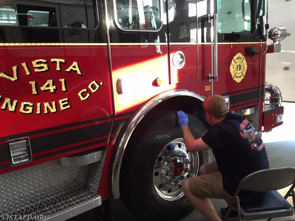 Asst. Chief Mike Peck cleaning Engine 141