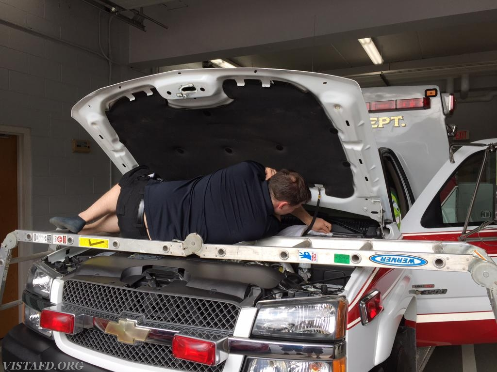 Foreman Mike Canil cleaning Ambulance 84B2