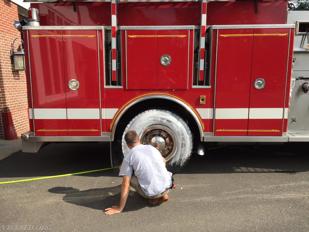 Capt. Brian Porco cleaning Engine 143