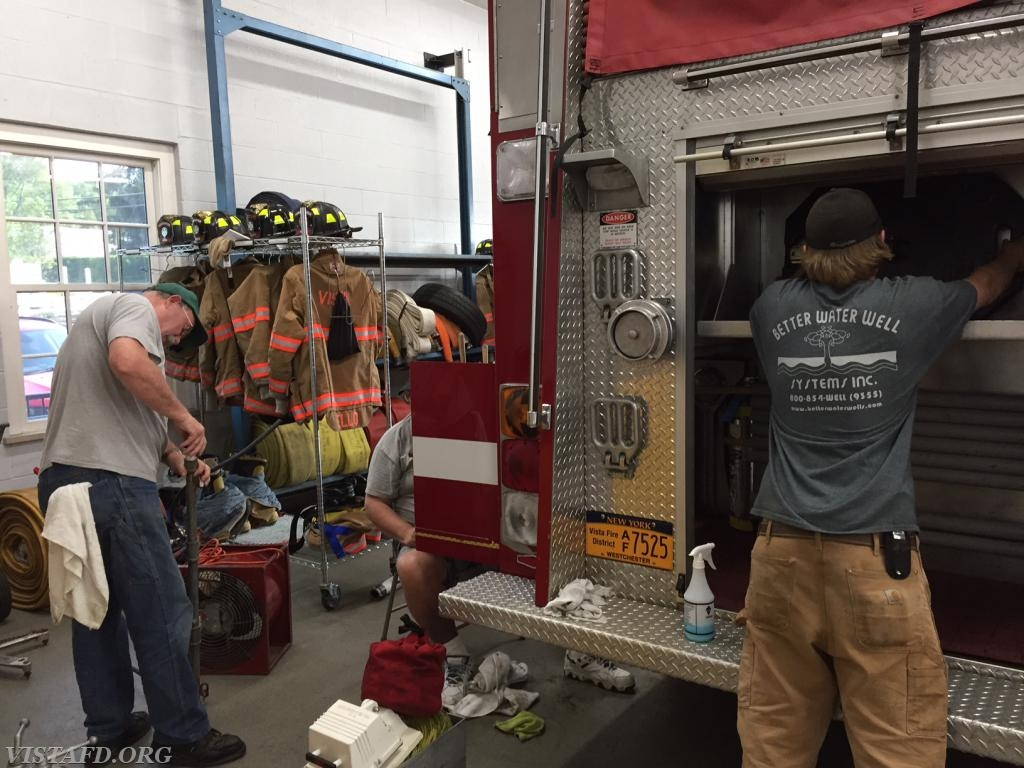 Ex-Chief Jim Hackett, Firefighter Ron Egloff and Firefighter Patrick Healy cleaning Engine 142