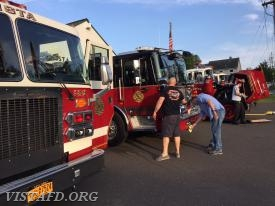 Vista Engine 143, Engine 141 and Tanker 4 apparatus crews cleaning their rigs for the Annual Inspection Dinner