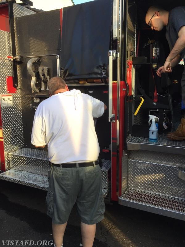 Ex-Chief Bill Dingee and Firefighter Ryan Ruggiero cleaning Engine 141
