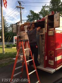 Foreman Dan Castelhano cleaning Engine 142