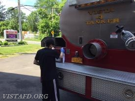 Firefighter Dom Mangone cleaning Tanker 4