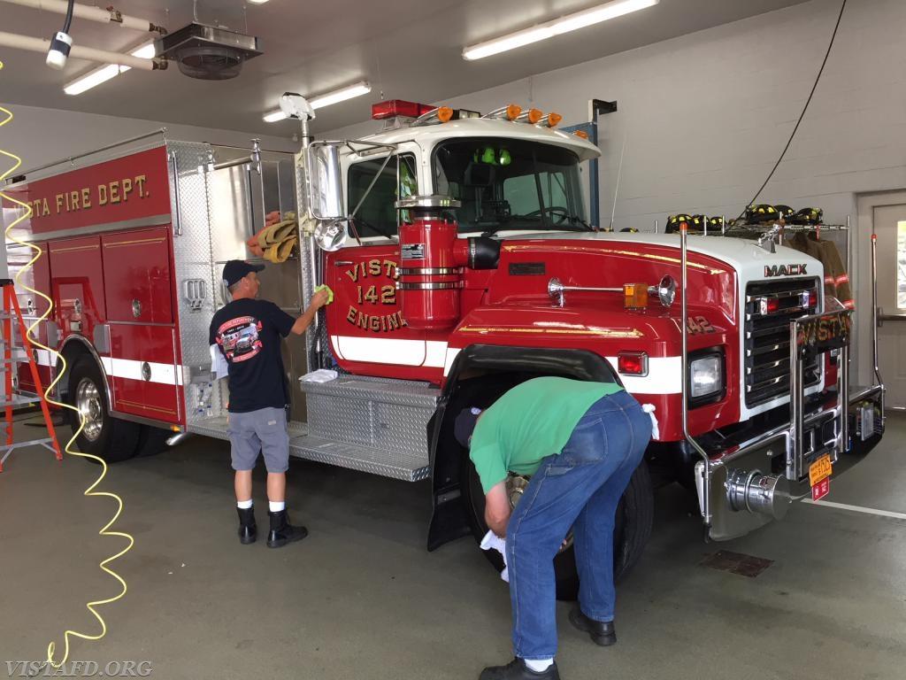 Lt. Phil Katz and Ex-Chief Jim Hackett cleaning Engine 142