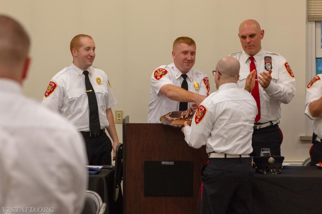 Firefighter Ryan Ruggiero receiving the 2017-2018 Vista Fire Department Firefighter of the Year award