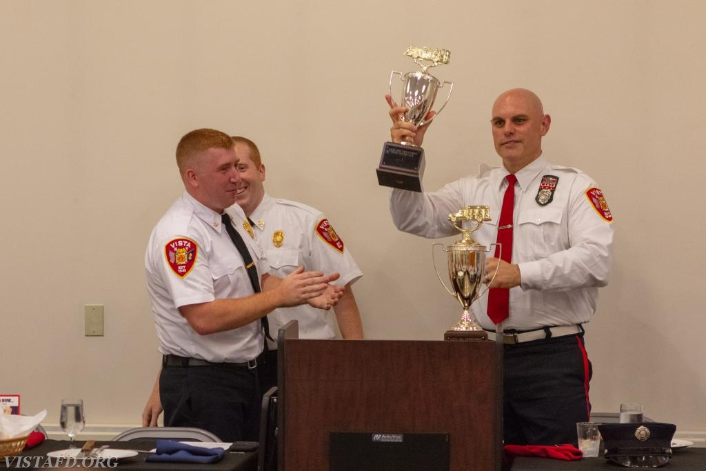 Asst. Chief Mike Peck and Lead Foreman Marc Baiocco receiving the 2017-2018 Vista Fire Department Best Fire Apparatus award for Engine 141