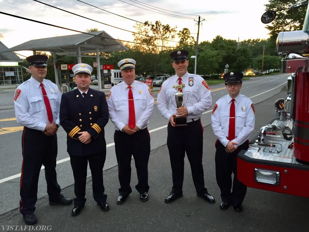 The Engine 141 crew with the Best Fire Apparatus Trophy