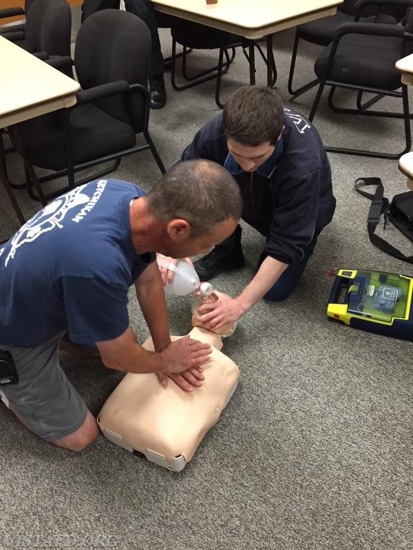 Lt. Phil Katz and Firefighter Dom Mangone performing CPR during the AHA CPR Class