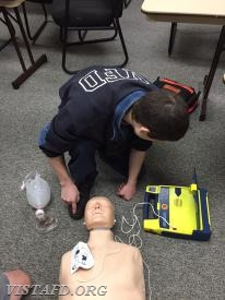 Firefighter Dom Mangone performing CPR during the AHA CPR Class