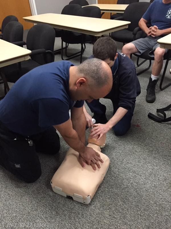 Foreman Dan Castelhano and Firefighter Dom Mangone performing CPR during the AHA CPR Class