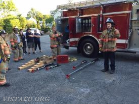 Firefighter Sean Kelly going over the vehicle stabilization tools & equipment