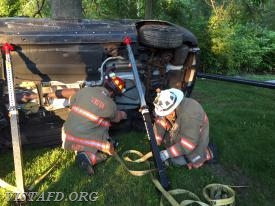 Vista Firefighters operating the stabilization struts and straps