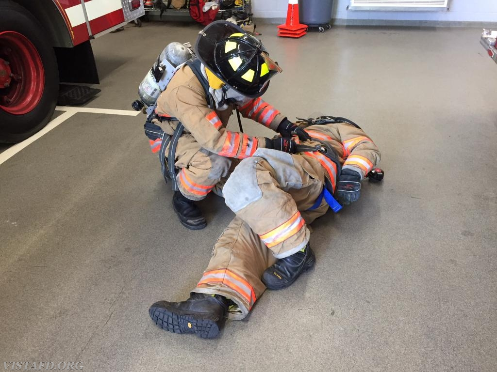 "Vista Firefighters practicing SCBA packaging during ""Advanced Firefighter Skills Class"""