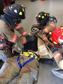 "Vista Firefighters practicing Firefighter CPR during ""Advanced Firefighter Skills Class"""