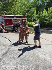 "Probationary Firefighter Finn Brannan learning how to advance an 1-3/4"" hose line during ""Firefighter Fundamentals Class"""