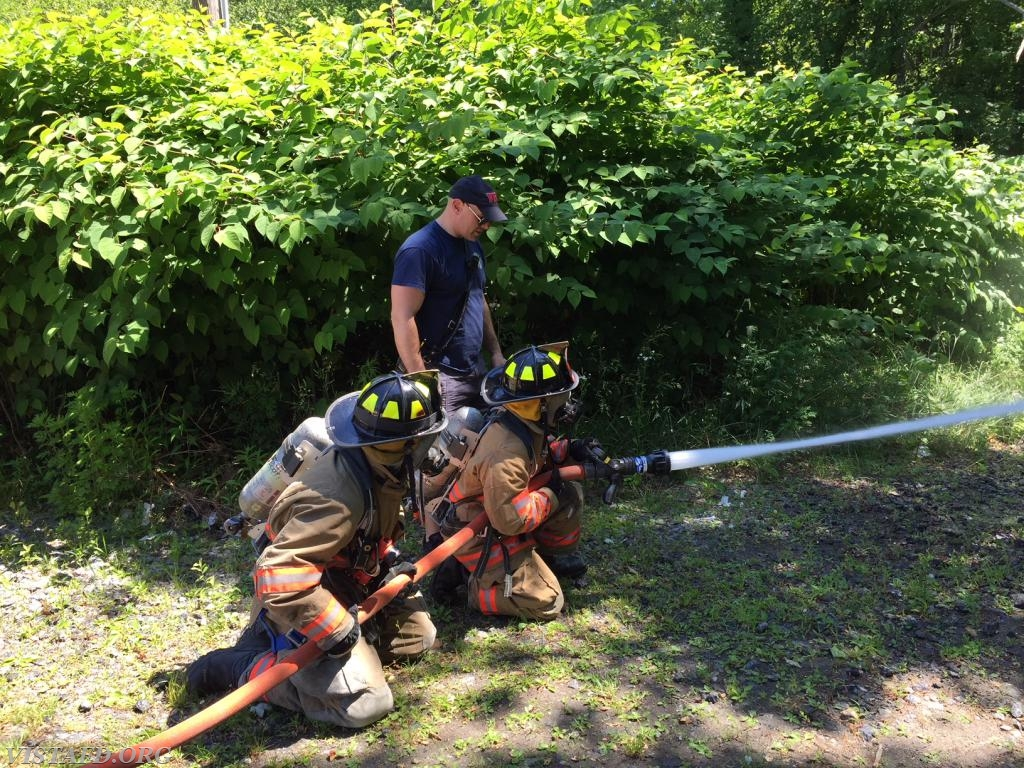 "Probationary FF Brannan and Probationary FF Sloan practicing how to operate an 1-3/4"" hose line"