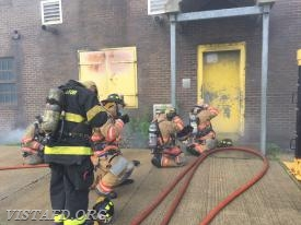 Vista Firefighters entering the propane burn building at the Westchester County Fire Training Center