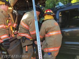 Lead Foreman Marc Baiocco and Lt. Wilmer Cervantes removing the patient during the extrication drill