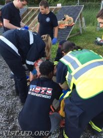 Vista EMS personnel packaging the patient