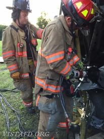 Lt. Phil Katz performing extrication operations as Firefighter Sean Kelly looks on