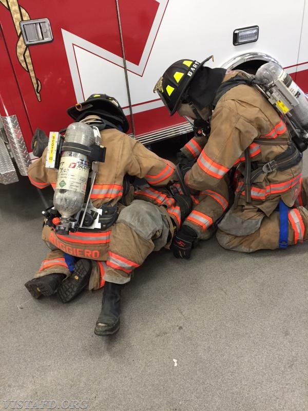 "Vista Firefighters practicing SCBA packaging during ""Advanced Firefighter Skills Training"""